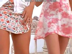 Dancing duet of two charming brunettes