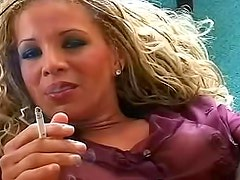 Girl with long curly hair smokes cigarettes