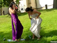 Bride and Maid of Honor Getting Wet With Champagne On The Wedding Day
