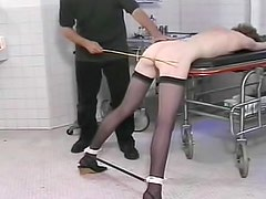 Painful whipping makes her cry