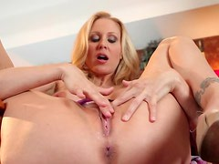 Busty MILF Julia Ann Plays With Her Big Boobs and Shaved Pussy