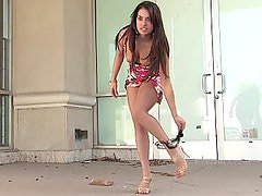 Stylish brunette flashing in public