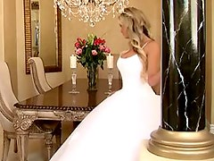 Bride in beautiful wedding dress spreading legs