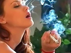 Smoking hot and attractive baroness is smoking cigarette on the sofa