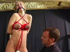 Red rope ties up her sexy natural tits