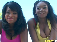 Amber Stars and Her Ebony Friend Sharing a White Cock Outdoors In Pool