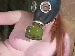 Masturbating freshie in gas mask