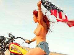 Redhead topless on a motorcycle