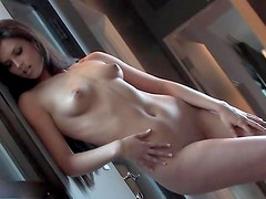Playboy girl exposes tiny tits