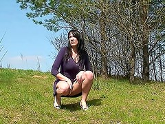 Short dress girl pees in the grass