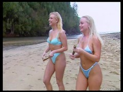 Sexy Blondes Wearing Bikinis Have A Group Sex Outdoors