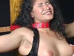 Bound and caned in a corset