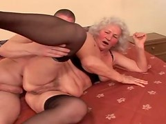Naughty granny in sexy lingerie enjoying younger cock