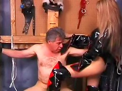 In sexy latex she sits on his face