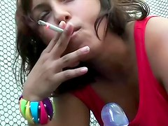 Playing with toy and smoking lustily