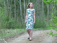 Sweet young girl goes pee outdoors