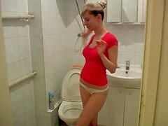 Naughty and thin Olga is pissing in the toilet