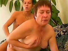 Short haired doll with hairy cunt is satisfying her young delivery boy
