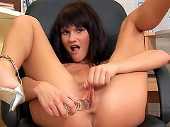 Crazy brunette in pink panties loves to fuck her kitty with sex toy on the chair