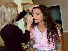 Putting makeup on a young lady