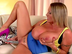 Fatty milf blonde with natural big tits likes to fuck her shaved vagina with big dildo