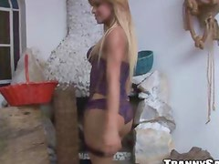 Sexy blonde tranny hottie taking off all her clothes