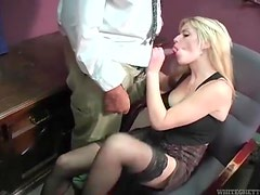 She kicks his balls and sucks another dick in office