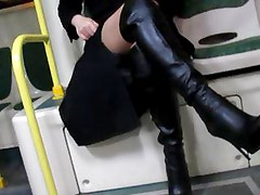 Girl in stockings and black leather boots flashing in a bus