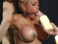 Mistress with two bound ladies in dungeon
