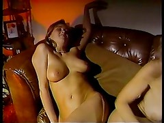 Hot lesbians enjoying on couch