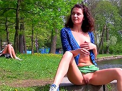 Girl shows off beneath some trees
