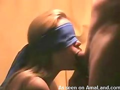 Blindfolded blonde sucking on dick
