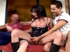 A horny shemale gives blowjobs to a couple of guys