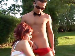 Mature redhead is banged in the park