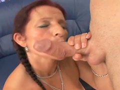 A hot redhead woman is getting her twat fucked hard