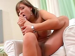 Solo girl and busty Vanda Vitus is masterfully licking her foot indoors