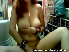Redhead with big tits masturbating