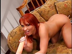 Two dicks in the redhead fuck holes
