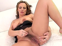 Red dildo fucks hairy natural milf