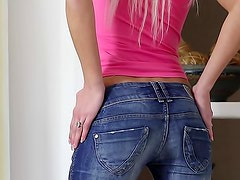 Light blonde Pinky strips her skinny jeans