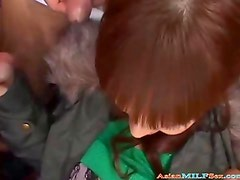 Hot Busty Milf In Coat Sucking Guys Cocks Licked And Fingered On The Couch
