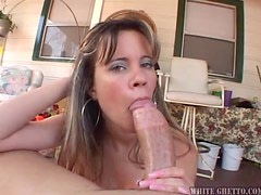 Brown-haired chick Lilly fingers her pussy and sucks a big fat cock