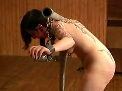Iron bondage keeps tattooed slut in place