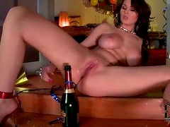 Champagne bottle in her shaved pussy