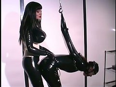 Tied Up Latex Slave