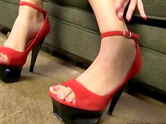 Geeky girl with glasses gives footjob