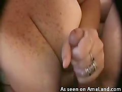 Big tits mature gives a hot handjob with cumshot