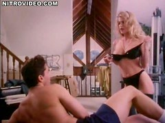 Busty Blonde Actress Beckie Mullen Performs a Cock-Bursting Striptease