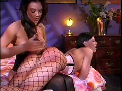 Gorgeous Lesbian Latex Sluts Having Some BDSM Action In Their Bedroom