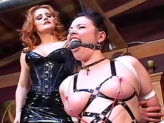 Latex mistress enjoys heavy bondage play